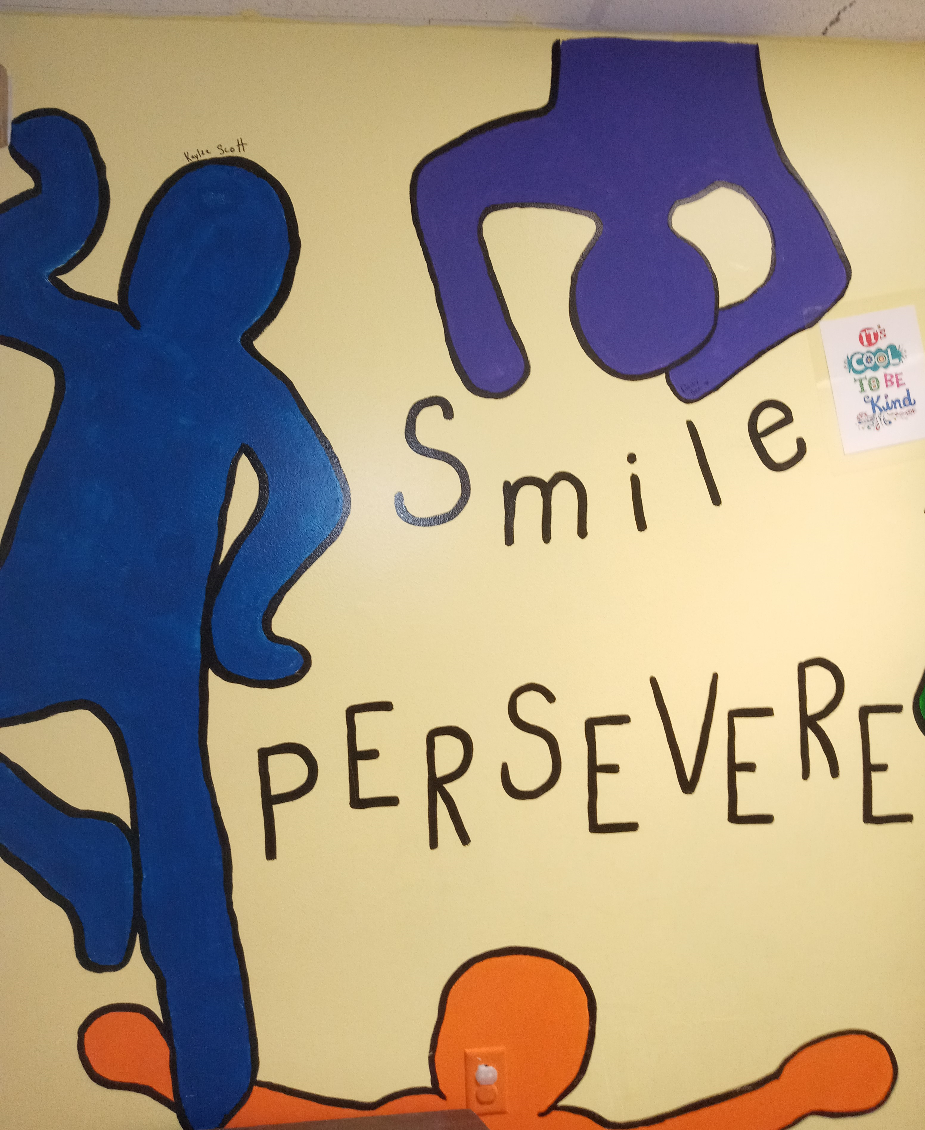 Smile and Persevere painted on the wall